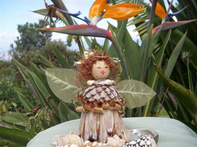 Dried Protea dolls and angels: These adorable dolls are handmade at No Ka Oi Protea farm from the dried Mink protea flower. Enjoy year after year on your Christmas tree or display in the case provided. The dolls and angels are shipped priority mail.